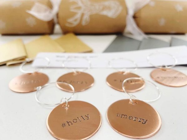 copper cracker charms with crackers, hats and jokes